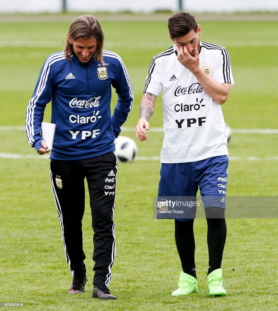 Lionel Messi of Argentina talks with Sebastián Beccacece second coach of Argentina during a training session at the team base camp on June 13, 2018 in Bronnitsy, Russia.