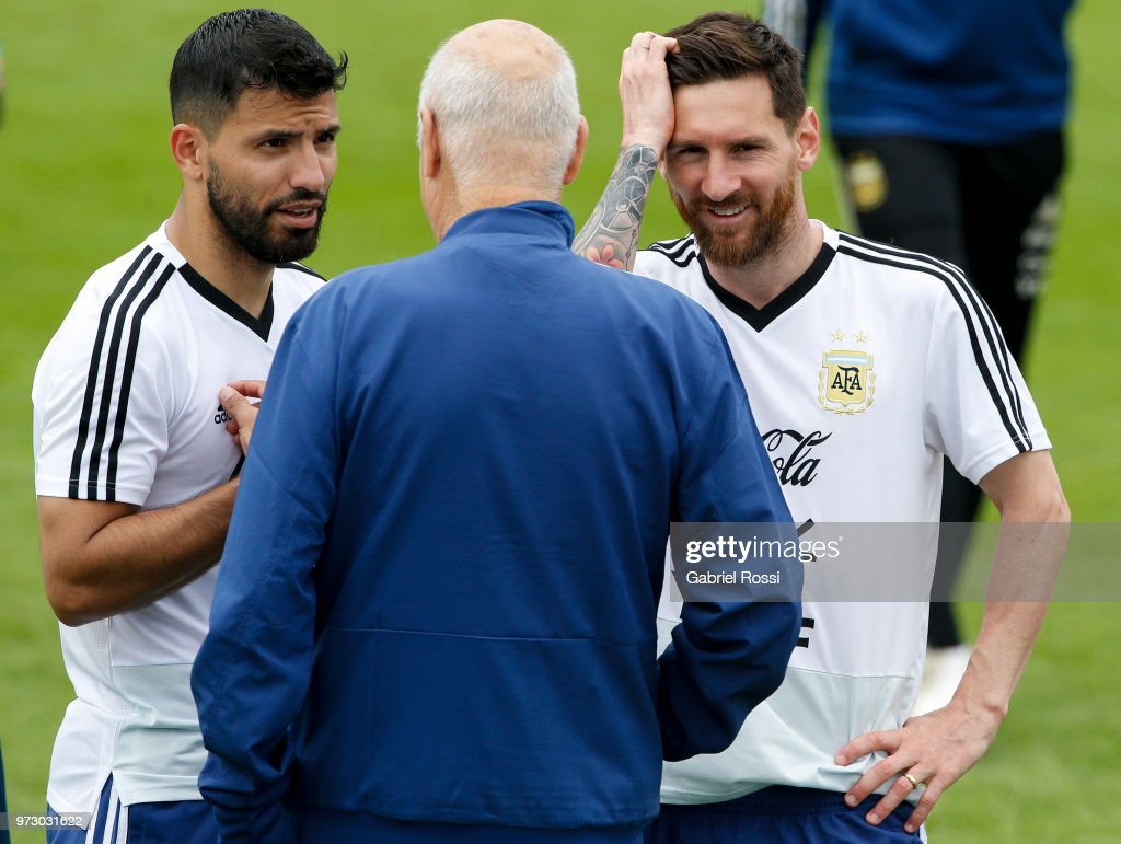 Lionel Messi of Argentina talks with Sergio Aguero of Argentina during a training session at the team base camp on June 13, 2018 in Bronnitsy, Russia.