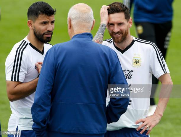 Lionel Messi of Argentina talks with Sergio Aguero of Argentina during a training session at the team base camp on June 13 2018 in Bronnitsy Russia