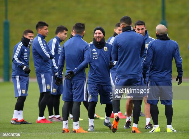 Lionel Messi of Argentina talks with team mates during a Argentina training session at Manchester City Football Academy on March 20 2018 in...