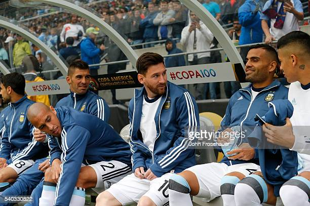 Lionel Messi of Argentina talks with teammates on the bench before a group D match between Argentina and Bolivia at Century Link Field as part of...