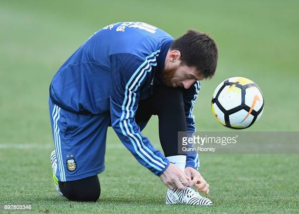 Lionel Messi of Argentina ties his shoe lace during an Argentina Training Session at City Football Academy on June 6 2017 in Melbourne Australia