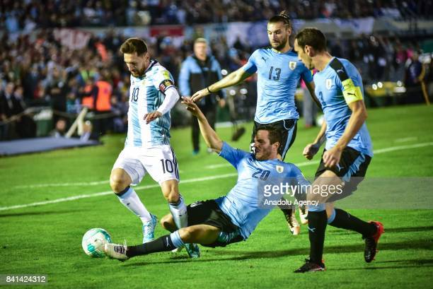 Lionel Messi of Argentina vies for the ball agains Gaston Silva and Alvaro Gonzalez of Uruguay during the 2018 FIFA World Cup qualifying match...