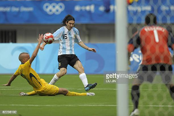 Lionel Messi of Argentina vies with Australia's Ruben Zadkovich during their 2008 Beijing Olympic Games first round Group A men's football match at...