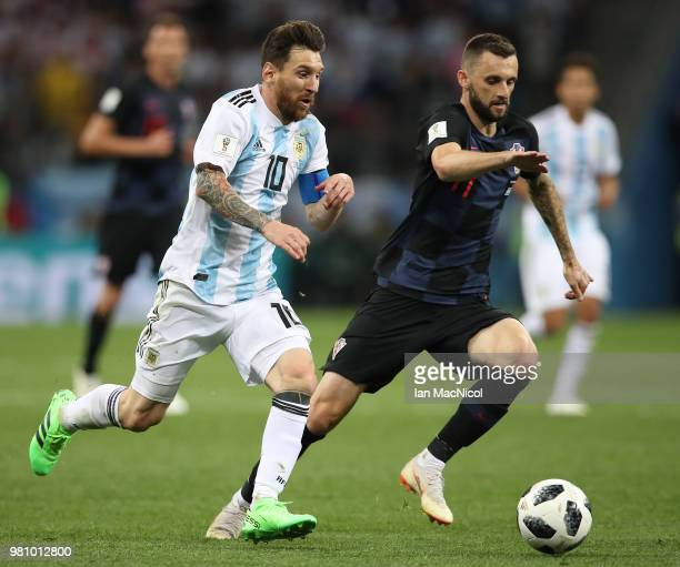 Lionel Messi of Argentina vies with Marcelo Brozovic of Croatia during the 2018 FIFA World Cup Russia group D match between Argentina and Croatia at...