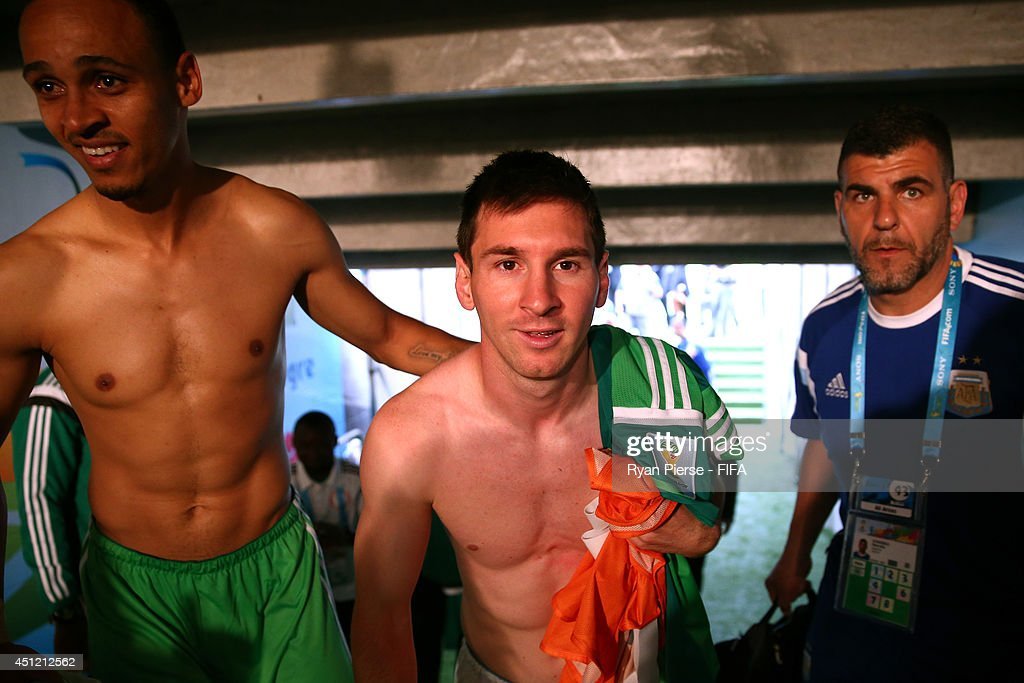 Lionel Messi (C) of Argentina walks in the tunnel after the 3-2 win in the 2014 FIFA World Cup Brazil Group F match between Nigeria and Argentina at Estadio Beira-Rio on June 25, 2014 in Porto Alegre, Brazil.