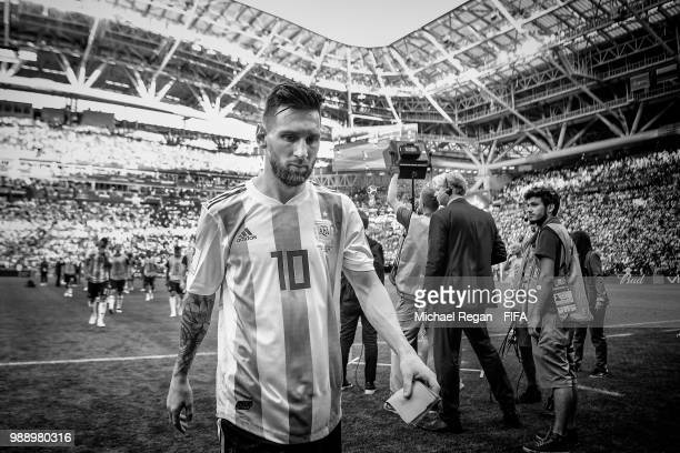 Lionel Messi of Argentina walks off dejected after the 2018 FIFA World Cup Russia Round of 16 match between France and Argentina at Kazan Arena on...
