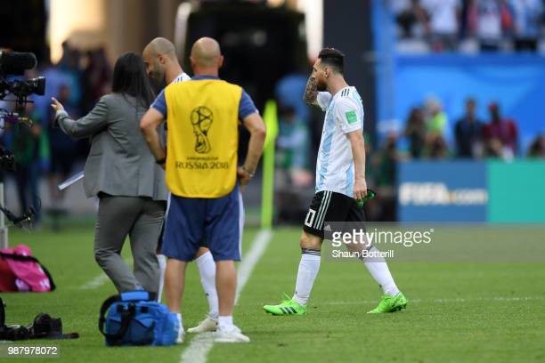 Lionel Messi of Argentina walks off the pitch dejecetd during the 2018 FIFA World Cup Russia Round of 16 match between France and Argentina at Kazan...