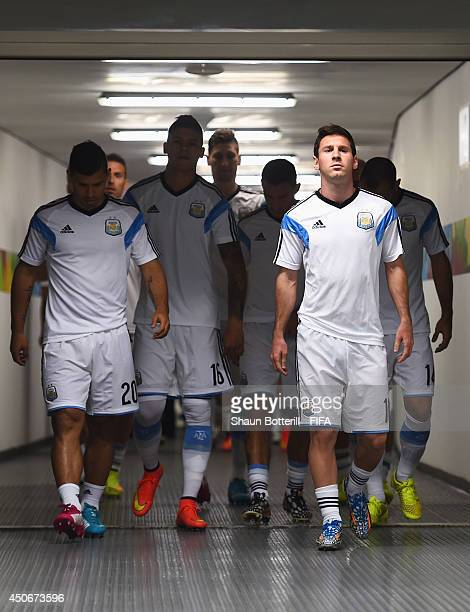 Lionel Messi of Argentina walks out for the warm up with team mates prior to the 2014 FIFA World Cup Brazil Group F match between Argentina and...