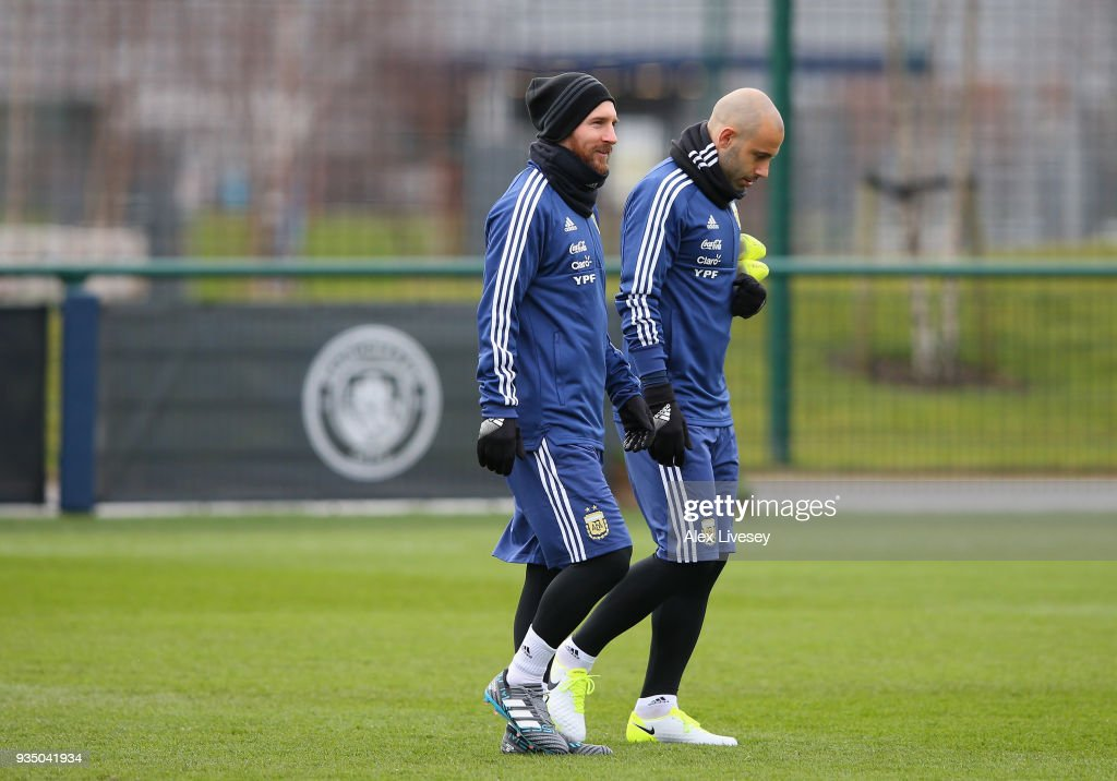 Lionel Messi of Argentina walks out with Javier Mascherano for a Argentina training session at Manchester City Football Academy on March 20, 2018 in Manchester, England.