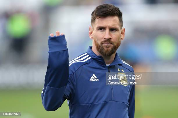 Lionel Messi of Argentina waves during warmups prior to the Copa America Brazil 2019 Third Place match between Argentina and Chile at Arena...