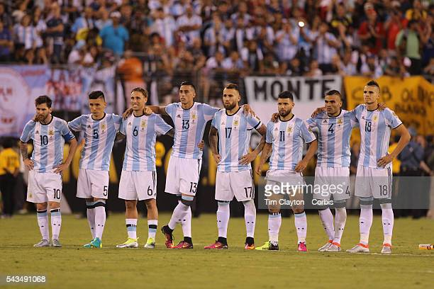 Lionel Messi of Argentina with team mates on the half way line after missing a penalty in the penalty shoot out during the Argentina Vs Chile Final...