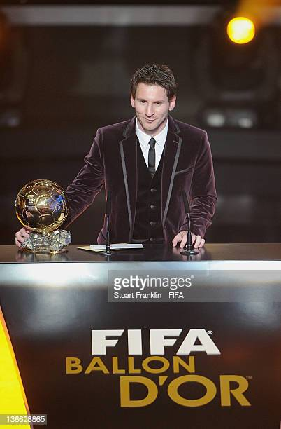 Lionel Messi of Argentina with the trophy after winning his third consecutive FIFA Ballon d'Or title at the FIFA Ballon d'Or Gala 2011 at the...