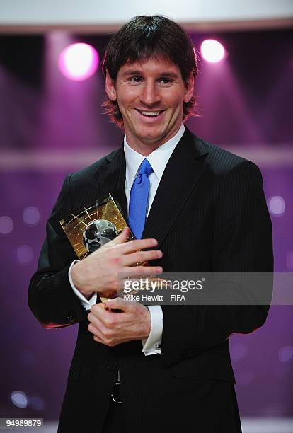 Lionel Messi of Barcelona and Argentina holds aloft the FIFA Men's Player of the Year award on December 21 2009 in Zurich Switzerland