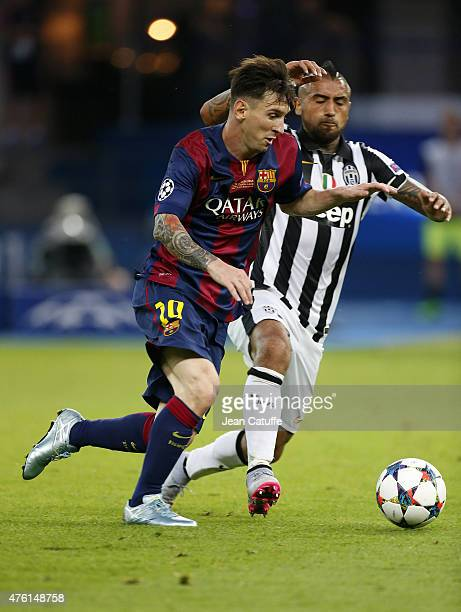 Lionel Messi of Barcelona and Arturo Vidal of Juventus Turin in action during the UEFA Champions League Final between Juventus Turin and FC Barcelona...
