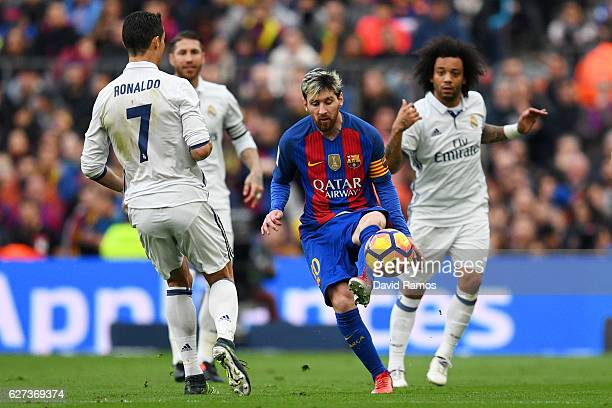 Lionel Messi of Barcelona and Cristiano Ronaldo of Real Madrid compete for the ball during the La Liga match between FC Barcelona and Real Madrid CF...