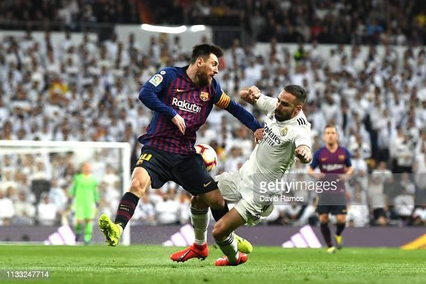 Lionel Messi of Barcelona and Daniel Carvajal of Real Madrid clash during the La Liga match between Real Madrid CF and FC Barcelona at Estadio...