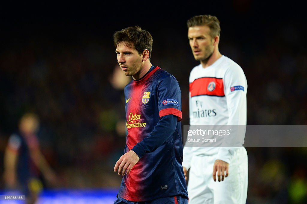 Lionel Messi of Barcelona and David Beckham of PSG in action during the UEFA Champions League quarter-final second leg match between Barcelona and Paris St Germain at Nou Camp on April 10, 2013 in Barcelona, Spain.