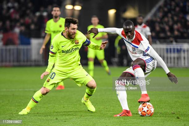 Lionel Messi of Barcelona and Ferland Mendy of Lyon during the UEFA Champions League round 16 first leg match between Lyon and Barcelona at Groupama...