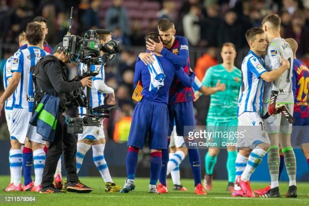 Lionel Messi of Barcelona and Gerard Pique of Barcelona embrace after the Barcelona V Real Sociedad La Liga regular season match at Estadio Camp Nou...