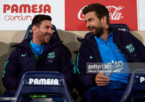 Lionel Messi of Barcelona and Gerard Pique of Barcelona talk on the bench prior to the La Liga match between Villarreal CF and FC Barcelona at...