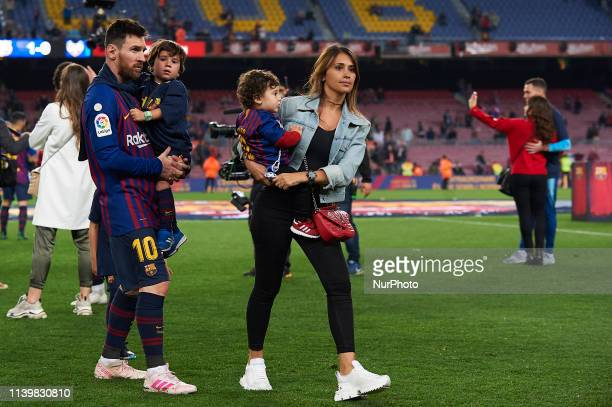 Lionel Messi of Barcelona and his family celebrate after Barcelona won their 26th league title at the end of the Spanish League football match...