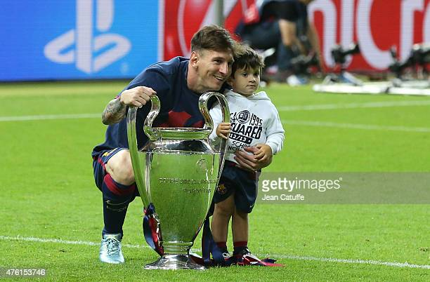 Lionel Messi of Barcelona and his son Thiago Messi celebrate the victory after the UEFA Champions League Final between Juventus Turin and FC...