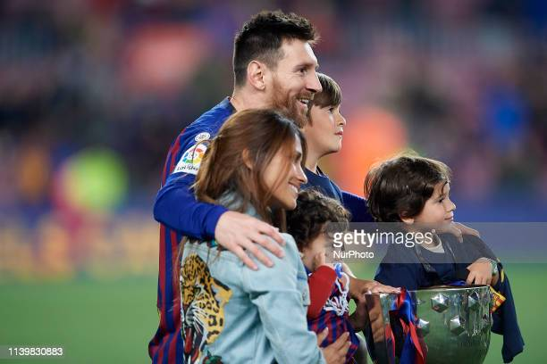 Lionel Messi of Barcelona and his wife Antonella Roccuzzo whit his sons celebrate after Barcelona won their 26th league title at the end of the...
