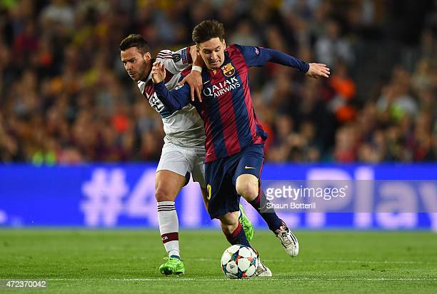 Lionel Messi of Barcelona and Juan Bernat of Bayern Muenchen battle for the ball during the UEFA Champions League Semi Final, first leg match between...
