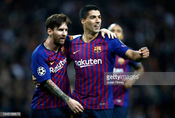 Lionel Messi of Barcelona and Luis Suarez of Barcelona celebrates after Lionel Messi scored their team's fourth goal during the Group B match of the...