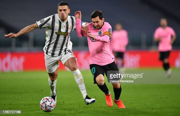 Lionel Messi of Barcelona and Merih Demiral of Juventus battle for the ball during the UEFA Champions League Group G stage match between Juventus and...