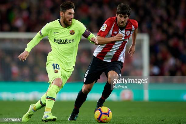 Lionel Messi of Barcelona and Mikel San Jose of Athletic during the week 23 of La Liga between Athletic Club and FC Barcelona at San Mames stadium on...