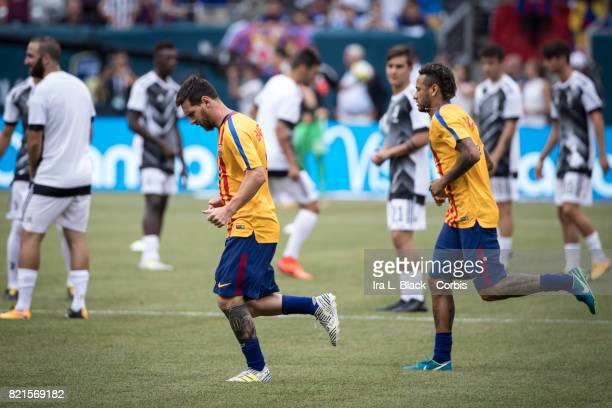 Lionel Messi of Barcelona and Neymar of Barcelona warm up prior to the International Champions Cup match between FC Barcelona and Juventus at the...