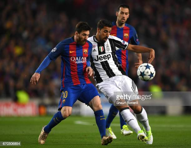Lionel Messi of Barcelona and Sami Khedira of Juventus battle for possession during the UEFA Champions League Quarter Final second leg match between...
