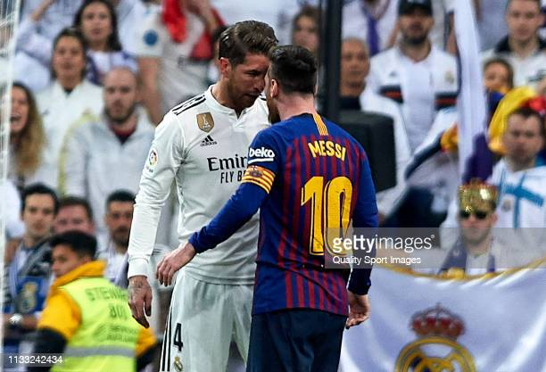 Lionel Messi of Barcelona and Sergio Ramos of Real Madrid argue during the La Liga match between Real Madrid CF and FC Barcelona at Estadio Santiago...