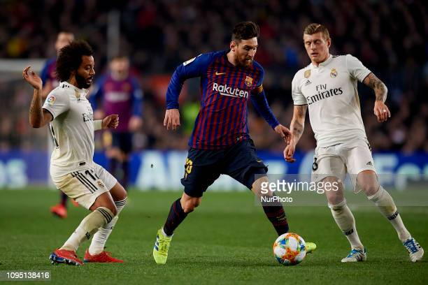 Lionel Messi of Barcelona and Toni Kroos and Marcelo of Real Madrid battle for the ball during the Spanish Cup first leg semifinal match between FC...