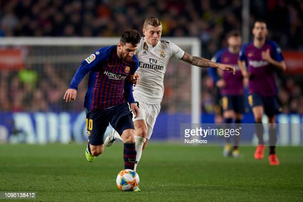 Lionel Messi of Barcelona and Toni Kroos of Real Madrid battle for the ball during the Spanish Cup first leg semifinal match between FC Barcelona and...