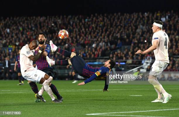 Lionel Messi of Barcelona attempts a over head kick as Phil Jones of Manchester United attempts to block during the UEFA Champions League Quarter...