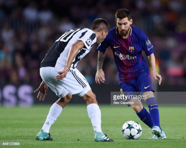 Lionel Messi of Barcelona attempts to get past Rodrigo Bentancur of Juventus during the UEFA Champions League Group D match between FC Barcelona and...