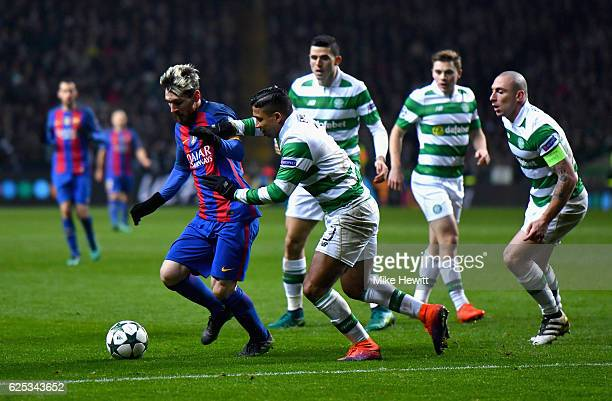 Lionel Messi of Barcelona attempts to take the ball past Emilio Izaguirre of Celtic during the UEFA Champions League Group C match between Celtic FC...