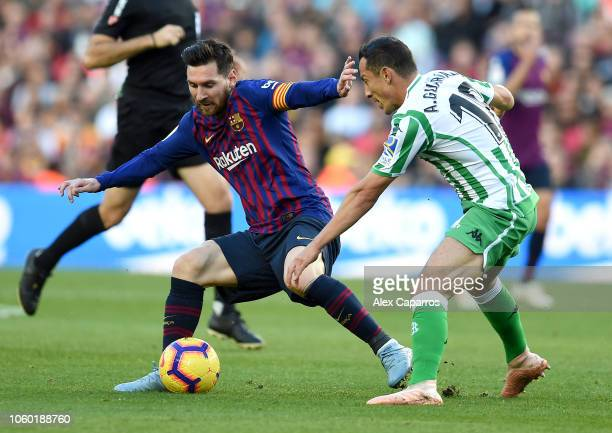 Lionel Messi of Barcelona battles for possession with Andres Guardado of Real Betis during the La Liga match between FC Barcelona and Real Betis...