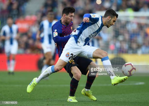 Lionel Messi of Barcelona battles for possession with Mario Hermoso of RCD Espanyol during the La Liga match between FC Barcelona and RCD Espanyol at...