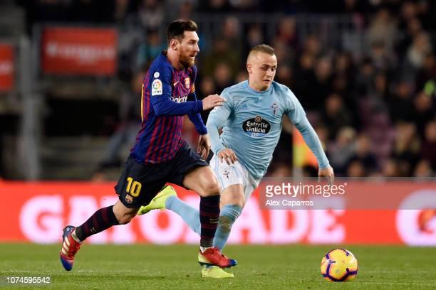 Lionel Messi of Barcelona battles for possession with Stanislav Lobotka of Celta Vigo during the La Liga match between FC Barcelona and RC Celta de...