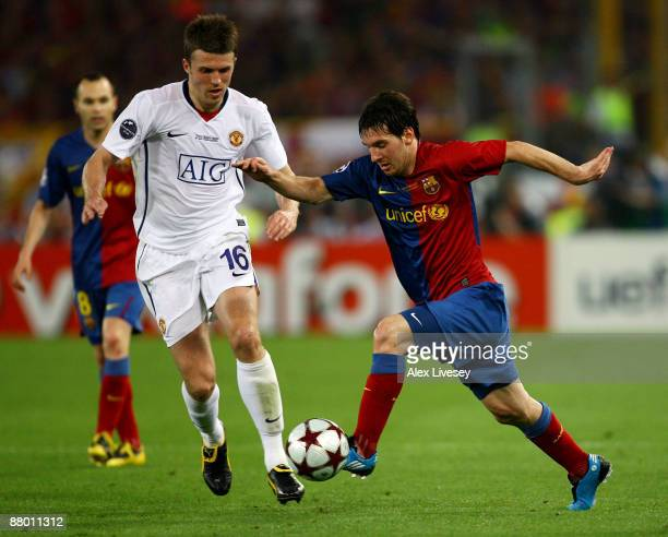 Lionel Messi of Barcelona battles for the ball with Michael Carrick of Manchester United during the UEFA Champions League Final match between...