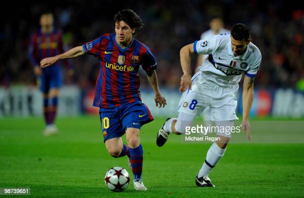 Lionel Messi of Barcelona battles Thiago Motta of Inter Milan during the UEFA Champions League Semi Final Second Leg match between Barcelona and...