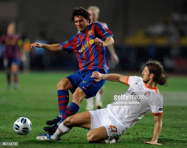 Lionel Messi of Barcelona battles with Dmytro Chygrynskiy of Shakhtar Donetsk during the UEFA Super Cup Final between FC Barcelona and Shakhtar...