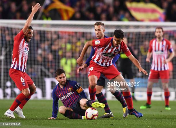 Lionel Messi of Barcelona battles with Rodri of Atletico Madrid during the La Liga match between FC Barcelona and Club Atletico de Madrid at Camp Nou...