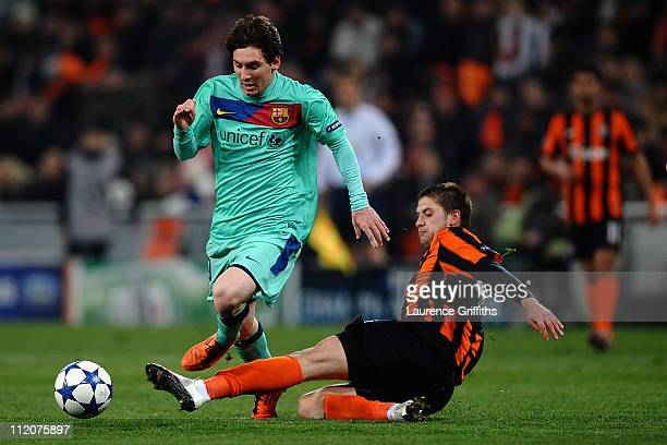 Lionel Messi of Barcelona battles with Yoroslav Rakitskiy of Shakhtar Donetsk during the UEFA Champions League Quarter Final 2nd Leg match between...
