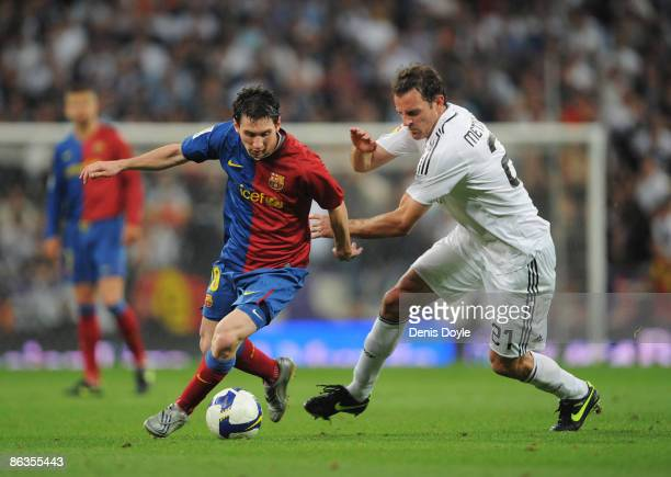 Lionel Messi of Barcelona beats Cristoph Metzelder of Real Madrid during the La Liga match between Real Madrid and Barcelona at the Santiago Bernabeu...