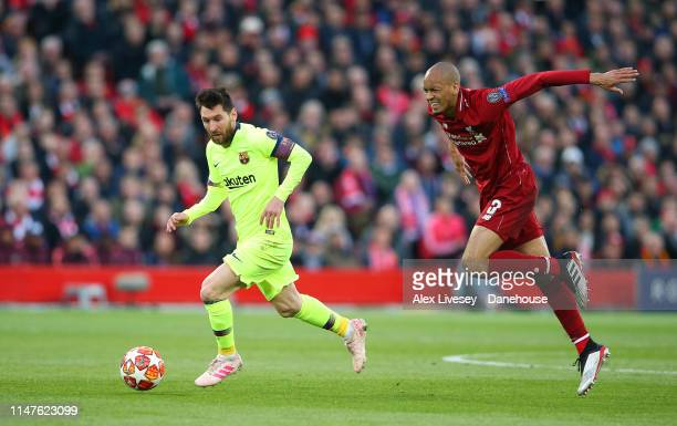 Lionel Messi of Barcelona beats Fabinho of Liverpool during the UEFA Champions League Semi Final second leg match between Liverpool and Barcelona at...